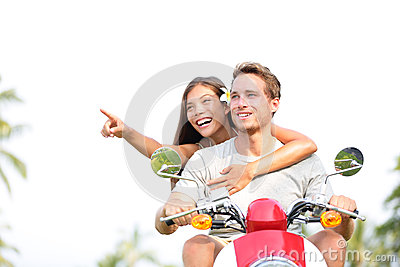 Scooter - couple lifestyle fun driving in summer