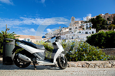 Scooter and panorama of Ibiza, Spain