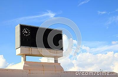 Score board on blue sky