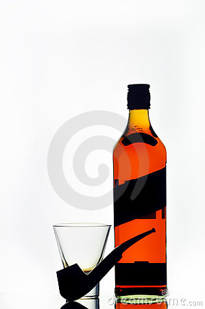 Scotch whiskey bottle, glass and pipe
