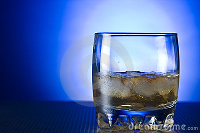 Scotch whiskey in glass with ice