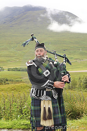 Scottish bagpiper Editorial Photo