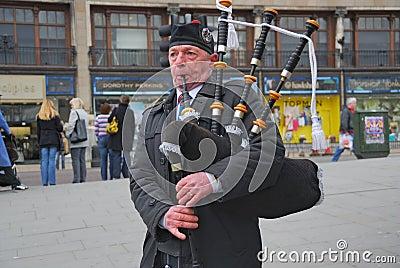 Scottish Bagpiper, Edinburg, Scotland Editorial Photo