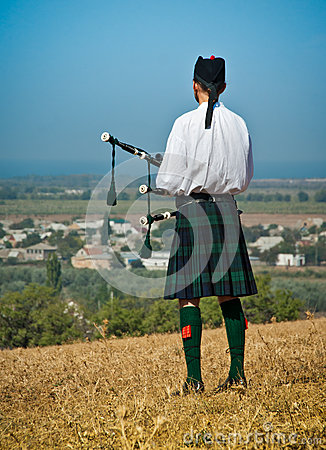 Scottish bagpiper in uniform Editorial Stock Image