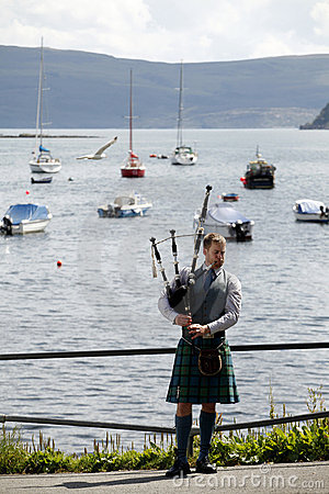 Scottish man with kilt and bagpipe Editorial Image