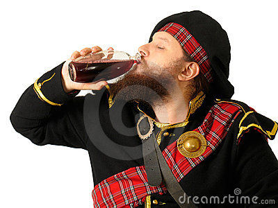 Scottish warrior drinking wine