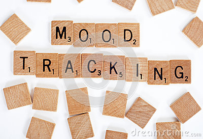 Scrabble tiles spelling out  Mood Tracking