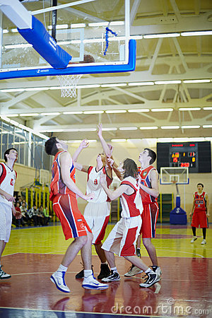 Scramble under basket in basketball game Editorial Stock Photo