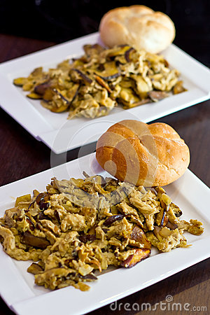 Scrambled eggs with forest mushrooms on the plate