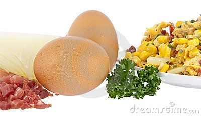 Scrambled eggs on plate with raw ingredients