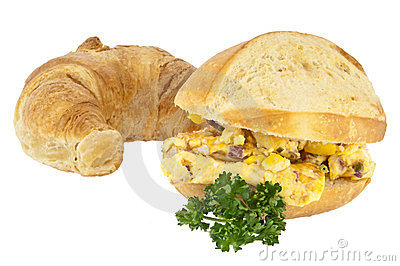 Scrambled eggs on a roll with croissant