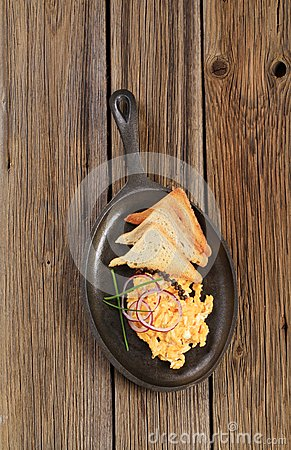 Scrambled eggs and toast