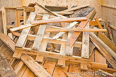 Scrap wood  in a recycling skip.
