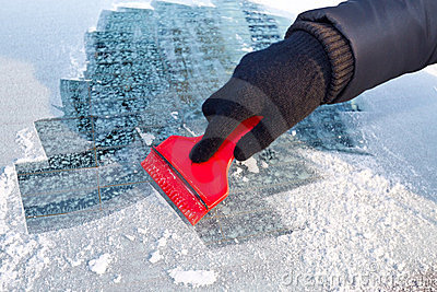 Scraping ice from the car