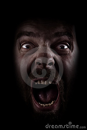 Free Scream Of Scared Spooky Man In Dark Royalty Free Stock Images - 15963709