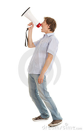 Screamimg young man holding megaphone