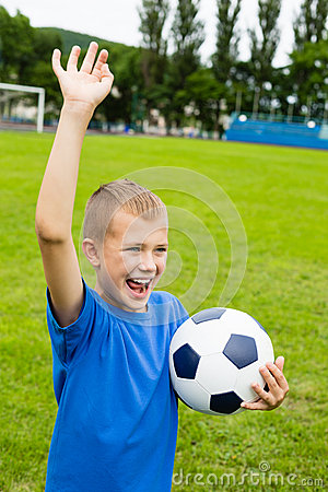 Screaming boy playing football.