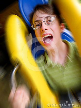 Screaming Boy Riding on a Roller Coaster