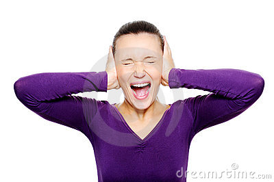 Screaming female face squeeze her ears by hand