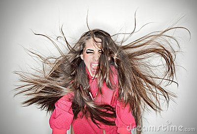 Screaming furious aggressive brunette woman