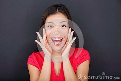 Screaming girl on black background