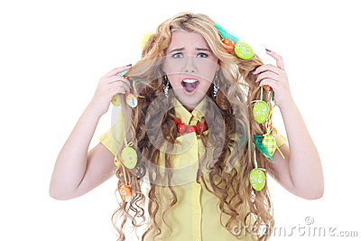 Screaming girl with easter eggs in her hair