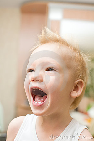 Screaming happy boy with funny hairstyle