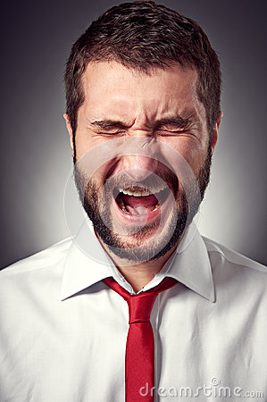 Screaming man over grey background