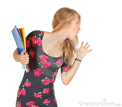Screaming university student girl with books