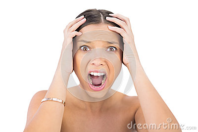Screaming woman holding hands on head