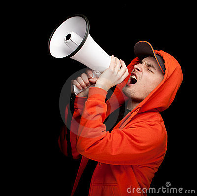Screaming young man with megaphone
