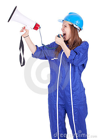 Screaming young woman in coveralls with megaphone