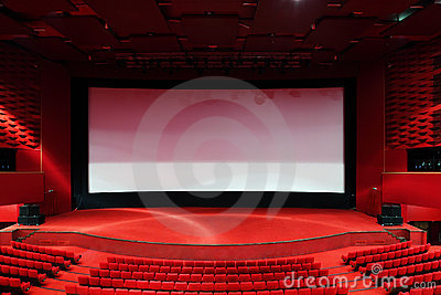 Screen and rows of chairs in cinema Stock Photo