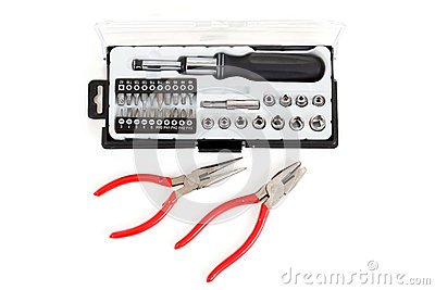 Screwdriver Bit Set with pliers on white