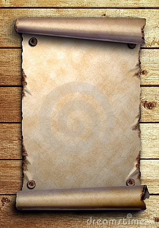 Scroll of old paper on wooden boards