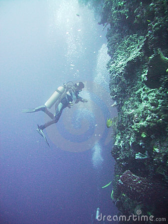 Scuba diver against cliff Underwater Cliff Diving