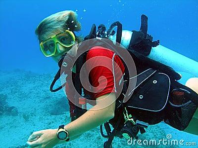 Scuba diver enjoys sunny dive