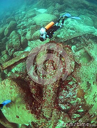 Scuba diver explores a wreck in the Indian Ocean Editorial Stock Photo
