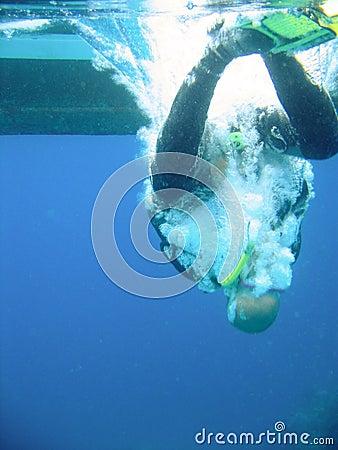 Scuba diver hitting water
