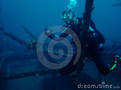 scuba diver photographing Frog fish Philippines