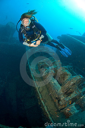Scuba diver on ship wreck