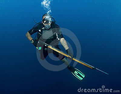 Scuba diver with spear gun