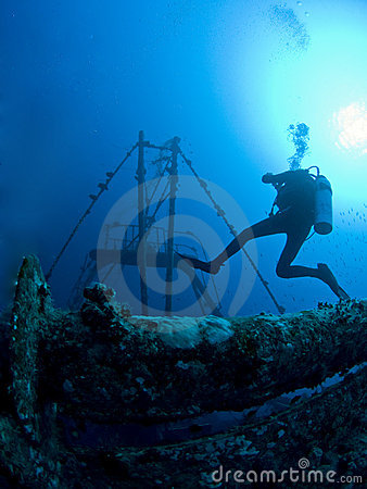 scuba diver at underwater wreck