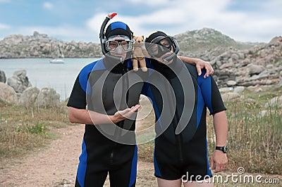 Scuba divers with teddy bear