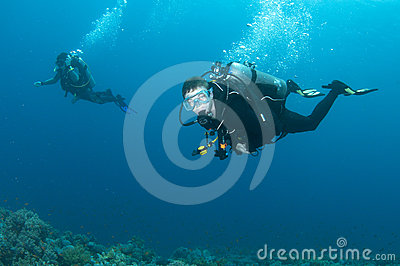 Scuba diving buddies enjoy a dive