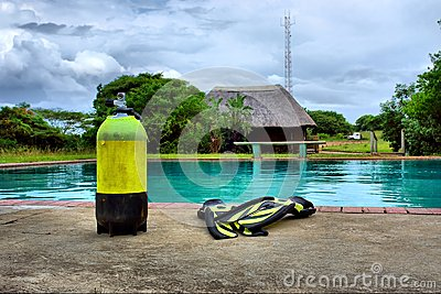 Scuba gear next to outdoor training pool