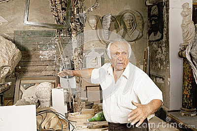 Sculptor in workshop