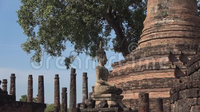Sculpture of a Buddha among the ruins of the ancient Buddhist temple. Sukhothai. Sculpture of a seated Buddha among the ruins of the ancient Buddhist temple Wat stock video footage