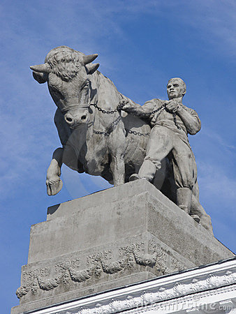Sculpture of farmer with a bull