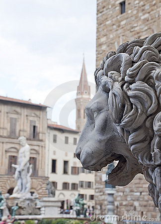 Sculpture in the foreground of a lion